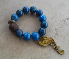 Beautiful Blue Jade Stretch Bracelet with Yellow Winged Gargoyle Charm