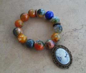 Orange and Green Faceted Fire Agate Stretch Bracelet with Beautiful Blue Cameo